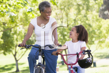 Royalty Free Photo of a Woman and Little Girl Biking