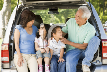 Royalty Free Photo of a Couple With Grandchildren in a Car