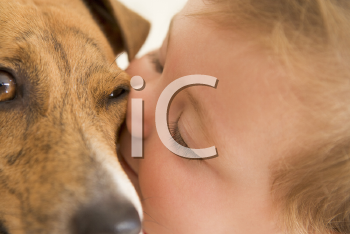 Royalty Free Photo of a Baby Kissing a Dog
