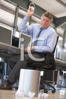Royalty Free Photo of a Man Throwing Garbage in a Bin