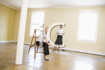 Royalty Free Photo of Two Women in an Empty Room