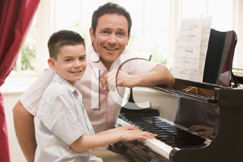 Royalty Free Photo of a Man and a Boy at a Piano