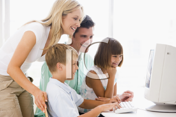 Royalty Free Photo of a Family at a Computer