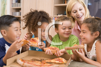Royalty Free Photo of Four Children Eating Pizza