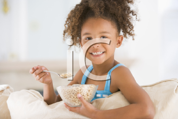 Royalty Free Photo of a Little Girl Eating Cereal