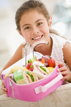 Royalty Free Photo of a Girl With a Lunchbox