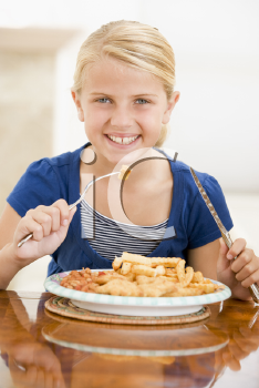 Royalty Free Photo of a Girl Eating Fish and Chips