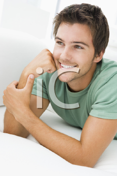 Royalty Free Photo of a Guy Lying on the Couch
