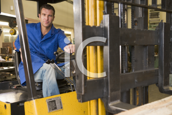 Royalty Free Photo of a Man in a Forklift