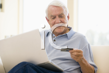 Royalty Free Photo of a Man With a Laptop and Credit Card