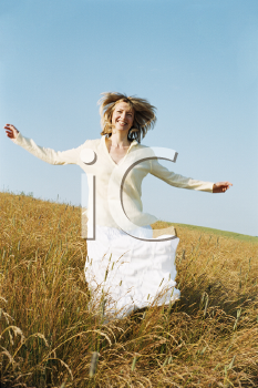 Royalty Free Photo of a Woman Running in the Country