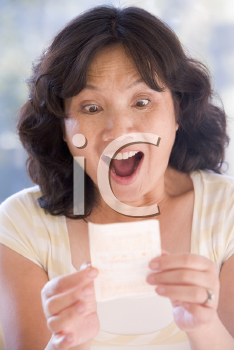 Royalty Free Photo of a Woman With a Winning Lottery Ticket