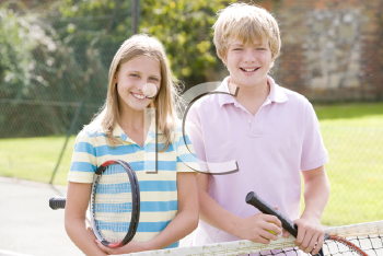 Royalty Free Photo of a Boy and Girl With Tennis Rackets
