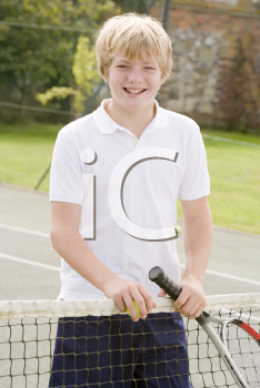 Royalty Free Photo of a Boy on a Tennis Court