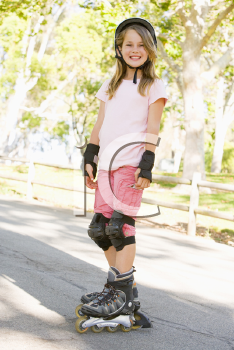 Royalty Free Photo of a Girl on Rollerblades