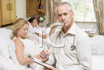 Royalty Free Photo of a Doctor With a Pregnant Woman