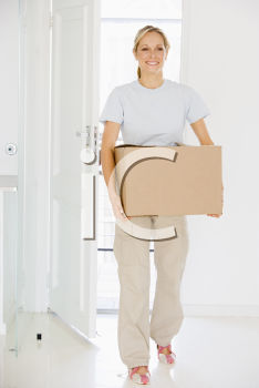 Royalty Free Photo of a Woman Moving In To a New Home