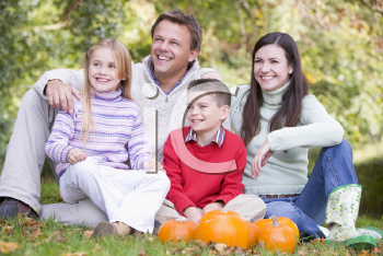 Royalty Free Photo of a Family With Pumpkins
