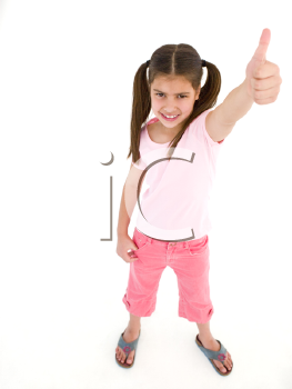Young girl giving thumbs up smiling