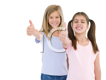 Royalty Free Photo of a Girl Giving a Thumbs Up
