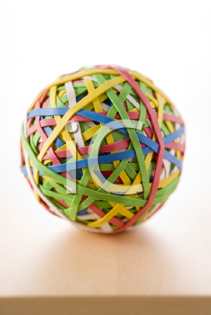 Royalty Free Photo of a Rubber Band Ball on a Desk