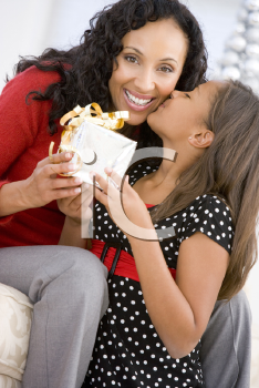 Royalty Free Photo of a Mother and Girl With a Gift