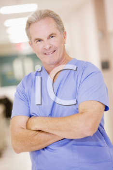 Royalty Free Photo of a Doctor Standing in a Hospital
