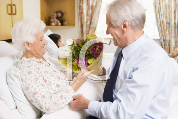 Royalty Free Photo of a Man Visiting His Wife in the Hospital