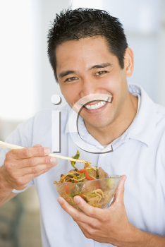 Royalty Free Photo of a Man Eating Chinese Food