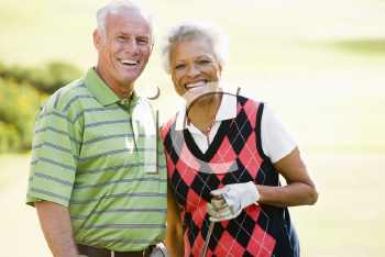Royalty Free Photo of a Couple Golfing