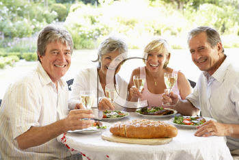 Royalty Free Photo of Friends Having Wine With Their Meal Outside