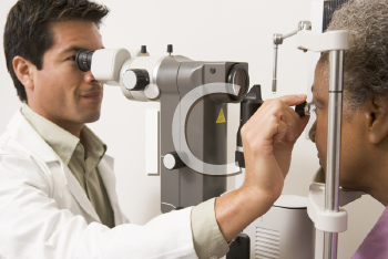 Royalty Free Photo of a Doctor Checking a Patient's Eyes