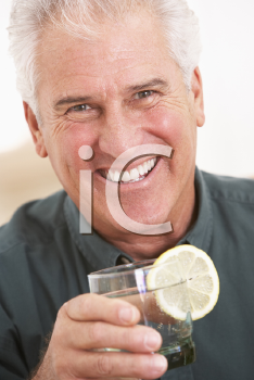 Royalty Free Photo of a Man Having a Drink