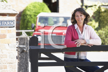 Royalty Free Photo of a Farm Wife at the Gate