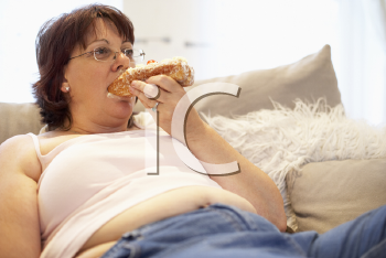 Royalty Free Photo of a Woman Eating Pastry