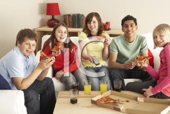 Royalty Free Photo of a Group of Children Eating Pizza