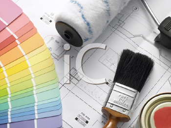 Royalty Free Photo of Paint Tools on House Plans