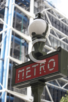 Royalty Free Photo of a Metro Sign in Paris France