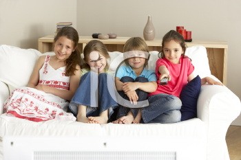 Royalty Free Photo of Children Watching Television