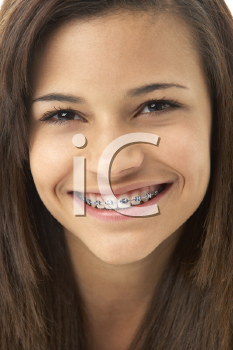 Royalty Free Photo of a Young Girl in Braces