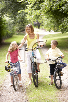 Royalty Free Photo of a Mother and Children Riding Bikes