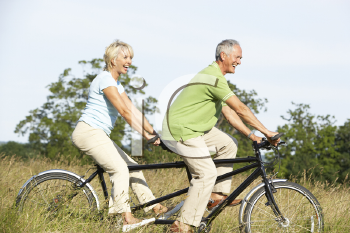 Royalty Free Photo of a Couple Riding a Tandem Bike