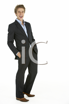 Studio Portrait Of Young Businessman Laughing