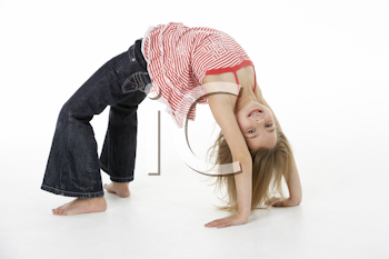Young Girl Doing Backflip In Studio