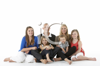 Shot Of Family Group Sitting In Studio