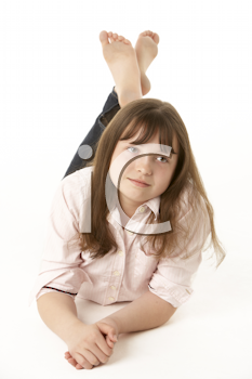 Thoughtful Young Girl Lying On Stomach In Studio