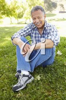 Senior  man sitting in park