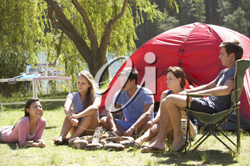 Group Of Young People On Camping Holiday Together