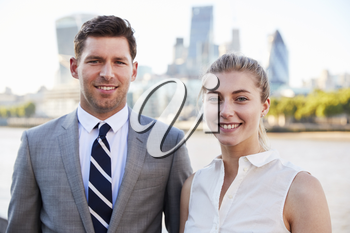 Portrait Of Businesspeople Standing By River Thames In London