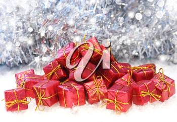 Christmas gifts in snow on a bokeh lights background